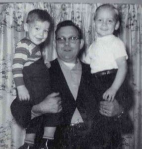 My Dad, holding my brother David and me, circa 1964.