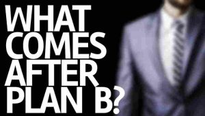 "Photo of the phrase, ""What Comes After Plan B?"" written on a board with a faded picture of a man in a suit coat in the background."