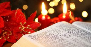 Photo of Open Bible with Christmas story and Christmas decorations.