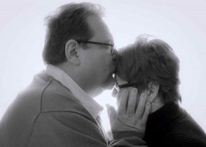 Black and white photo of Paul kissing Debbie.
